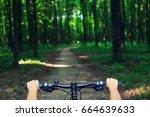mountain biking down hill... | Shutterstock . vector #664639633