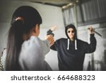 woman pointing a shotgun to... | Shutterstock . vector #664688323