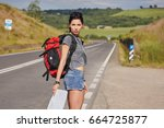 girl holding map with backpack... | Shutterstock . vector #664725877