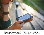 girl reading e book in sunny...   Shutterstock . vector #664739923