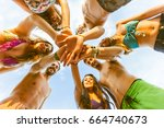 group of friends with hands on... | Shutterstock . vector #664740673