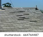 old gray asphalt roof | Shutterstock . vector #664764487
