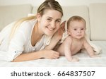 happy smiling mother and baby... | Shutterstock . vector #664837507