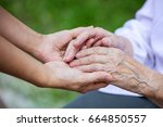 hands of young adult and senior ... | Shutterstock . vector #664850557