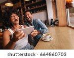 happy man and woman having fun... | Shutterstock . vector #664860703