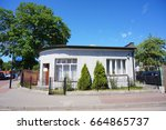 Small photo of JASTARNIA, POLAND - JUNE 19, 2017: Low house with fence on a street corner