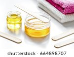 wax for depilation on white... | Shutterstock . vector #664898707