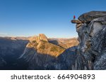 a fearless hiker is standing on ... | Shutterstock . vector #664904893
