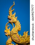 Small photo of Dragon ornamentation at Thai temple roof