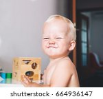 cute toddler frowns and... | Shutterstock . vector #664936147