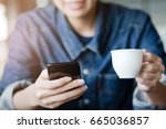 young woman using mobile smart...   Shutterstock . vector #665036857
