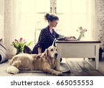 Small photo of Woman Petting Golden Retriever Dog