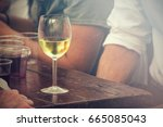 cool glass of wine on table ...   Shutterstock . vector #665085043