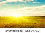 Yellow Field Of Haystacks Unde...
