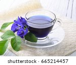 blue pea tea on white wooden... | Shutterstock . vector #665214457