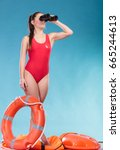 lifeguard with ring buoy... | Shutterstock . vector #665244613