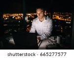 mature businessman working on a ... | Shutterstock . vector #665277577