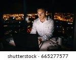 mature businessman working on a ... | Shutterstock . vector #665277577