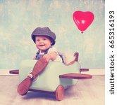 Little Baby Girl In Wooden...