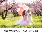 mother with child girl playing... | Shutterstock . vector #665331913