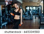 young sporty woman in the gym... | Shutterstock . vector #665334583