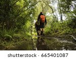 male hiker with orange backpack ... | Shutterstock . vector #665401087