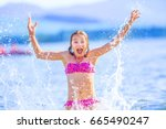 Cute Young Girl Playing In The...