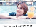 young woman with cocktail in... | Shutterstock . vector #665520997