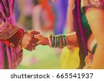 bride and groom hands   indian... | Shutterstock . vector #665541937