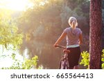 beautiful blonde girl riding on ... | Shutterstock . vector #665564413