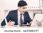 young man is working at a... | Shutterstock . vector #665588197