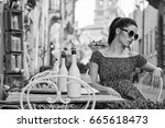 woman sitting at the cafer on... | Shutterstock . vector #665618473
