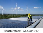 fitting photovoltaic panels on... | Shutterstock . vector #665634247