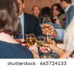 people clink wineglasses with... | Shutterstock . vector #665724133