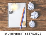 glowing white light bulb with... | Shutterstock . vector #665763823