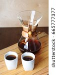 Small photo of Alternate coffee brewing with filter. Rustic background, white cups