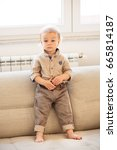 nicely dressed little boy with... | Shutterstock . vector #665814187