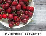 Red Cherries In White Bowl...