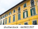 yellow building with green... | Shutterstock . vector #665821507
