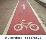 bike lane in red color | Shutterstock . vector #665876623