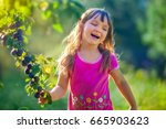 girl with branch of plum in... | Shutterstock . vector #665903623