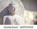The White Stone Buddha Statue...