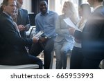 mix race businesspeople meeting ... | Shutterstock . vector #665953993