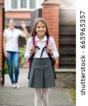 young mother standing in... | Shutterstock . vector #665965357