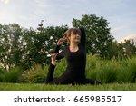 young happy beautiful barefoot... | Shutterstock . vector #665985517