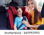 mid shot of smiling mother... | Shutterstock . vector #665992993