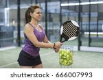 woman training paddle tennis... | Shutterstock . vector #666007993
