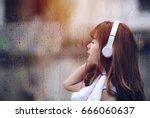 young woman with headphones... | Shutterstock . vector #666060637