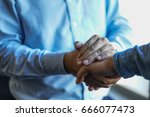 Small photo of Hand holding at business meeting happens after shaking hand. Two businessmen have confidence to do the business together. Growth company will exist soon.