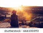 a tourist girl in a hat sits on ... | Shutterstock . vector #666100393
